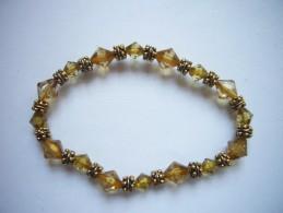 Neuf - Bracelet élastiqué Perles Façon Cristal à Facettes Brun Ocre Mordoré Et Perles Dorées Laiton - Bracciali