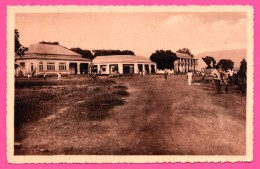 Bangui - Oubangui - Place Edouard Renard - Les Magasins Artiaga, Santos Noguera Et Sultanat - Animée - Photo SUZY - 1938 - Centraal-Afrikaanse Republiek