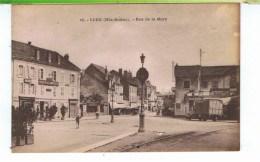 CPA-70-LURE-RUE DE LA GARE-ANIMEE-PERSONNAGES-1CAMION-HÔTEL DU COMMERCE- - Lure
