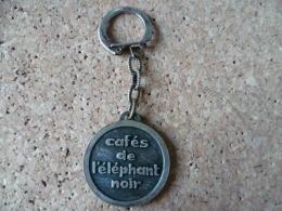 Porte Clé **Cafés De L´Elephant Noir ** Café ,boisson,animal (voir Photos) - Llaveros