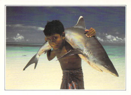 Asie > MALDIVES  (B) Islands White Tipped Shark Carried By A Young Child (enfant -requin à Pointe Blanche)   *PRIX FIXE - Maldives