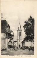 CPA - MUNSTER (68) - Aspect De L'Eglise Et Du Bazar Ulmer Dans Les Années 30 - Munster