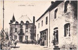63. LARODDE. Une Rue - Autres Communes
