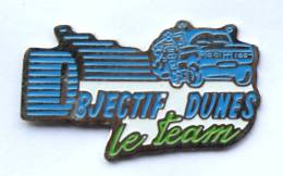 Pin´s OBJECTIF DUNES Le Team  - Moto Et Voiture De Rallye - Ferrier - F380 - Rallye
