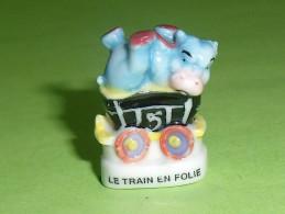 Fèves / Autres / Divers :train En Folie , Hippopotame   T79 - Otros