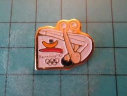 PIN1415b Pin´s Pins /      SPORT : GYMNASTIQUE ANNEAUX BARCELONE JEUX OLYMPIQUES 1992   INSCRIPTION AU DOS ,  Voir Photo - Giochi Olimpici