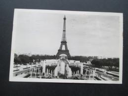 AK / Echtfoto Eiffel Turm 1948 Mit Sonderstempel / Vignetten. La Tour Eiffel - France