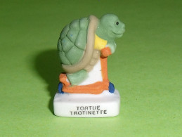 Fèves / Animaux : Tortue, Trotinette   T95 - Dieren