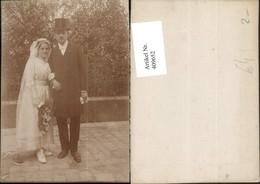 409652,Foto Hochzeitsfoto Brautpaar Brautstrauß Zylinder - Hochzeiten