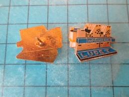 PIN1215c Pin´s Pins /       MARQUES : IMPRIMERIE LUDET GROSSE MACHINE ROTATIVE  ?    INSCRIPTION AU DOS ,  Voir Photo N° - Trademarks