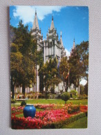 Salt Lake Temple. The Famous Mormon Temple (requiring 40 Years To Complete) With One Of The Many Beautiful Flower Garden - Salt Lake City