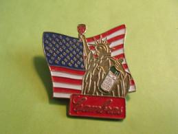 Pin's / Personnages Célèbres  : Amérique , Cambras , Statue De La Liberté  TB2a - Personnes Célèbres
