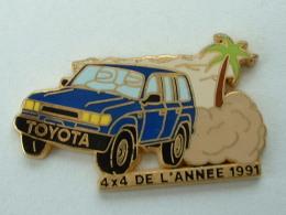 Pin´s TOYOTA BLEUE  - 4 X 4 DE L'ANNEE 1991 - ARTHUS BERTRAND - Toyota