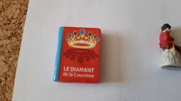 1 Feve Livre Le Diamant De La Couronne - Santons/Fèves