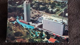 CPSM  COTE D IVOIRE ABIDJAN L HOTEL IVOIRE AFRIQUE NOIRE TIMBRE CONFERENCE BONNE VOLONTE CONTOUR AFRIQUE - Costa De Marfil