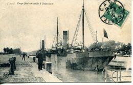 N°59 L -cpa Cargo Boat En écluse à Ouistreham - Commerce