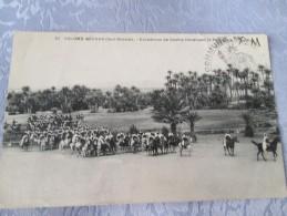 COLOMB BECHAR . ESCADRONS DE SPAHIS TRAVERSANT LA PALMERAIE . CACHET MILITAIRE  . TAXE - Bechar (Colomb Béchar)