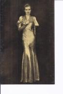 1 CP. Robe Lamé Argent Tramée Bleu Ciel De Marcel Rochas.  Modèle 1933 - Expositions