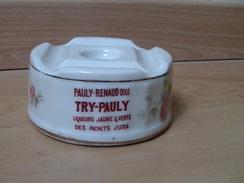 Ancien Cendrier Publicitaire En Porcelaine Pauly Renaud Dole - Try Pauly Liqueurs Jaune & Verte Des Monts Jura - Porcelaine
