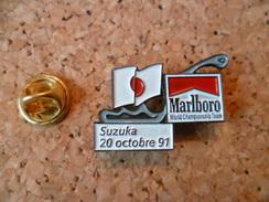 Pin's ** Circuit Automobile  Suzuka -20 Octobre 91 - Marlboro -wold Championship Team** Formule 1 - F1- - F1