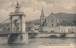 74 - SEYSSEL - Haute-Savoie - L'église Et L'entrée De La Rue Principale - Seyssel