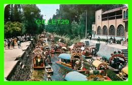 MEXICO - TRAJINERAS DECORADAS CON FLORES PASEAN A LOS CANALES DE ZOCHIMILCO - - Mexico