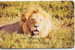 ZIMBABWE  PHONECARD (CHIP) LION  -ZIM 25-USED(bx1) - Zimbabwe