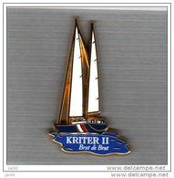 Pin´s  Bateau  Voilier  KRITER II  Avec  Boisson  KRITER  Brut  De  Brut  ( ARTHUS  BERTRAND ) - Arthus Bertrand