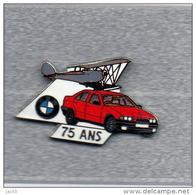 Pin´s  Avion, Automobile  B M W  Rouge  75  Ans  Verso  Sigle  BMW  Et  Démons  Et  Merveilles - BMW