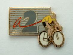 PIN'S CYCLISME TOUR DE FRANCE   - ANTENNE 2 - ARTHUS BERTRAND - Arthus Bertrand