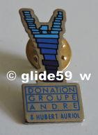 Pin's Donation Groupe André Et Hubert Auriol - Autres