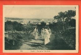 IAN-29  Tunis, Vue Sur La Ville Arabe. Femmes Voilées. Circulé Sous Enveloppe - Tunisia