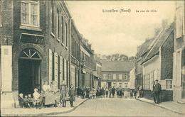 AK Linselles (Nord), La Rue De Lille, O 1917 Feldpost (6468) - Altri Comuni