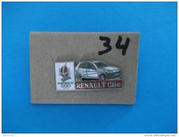 "PIN´S - RENAULT ""   RENAULT CLIO   Pub Sponsor  J O  Albertville 92   ""  - Voir Photo ( 34 ) - Renault"