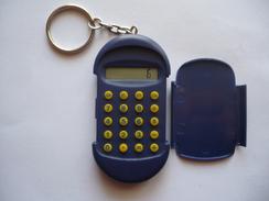 Porte Clés Plastique Calculatrice - TOURNOI DU BOULODROME  30-07-2000 - Pétanque - Bowls - Pétanque