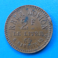 PUBLICITAIRE Au Génie Rhum Novion (Guadeloupe ?) 65 Rue Rambuteau - Monetari / Di Necessità