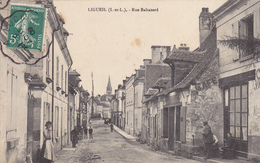 37 LIGUEIL. CPA  ANIMATION RUE BALTAZARD. ANNÉE 1909 - France