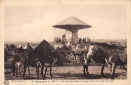 MAROC   CAMPAGNE DU RIFF - UN MANEGE DANS LES PAYS NOUVELLEMENT SOUMIS   MILITARIA  MANEGE FORAIN - Maroc
