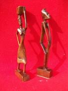 2 STATUETTE CON UOMO E DONNA IN LEGNO - Art Africain