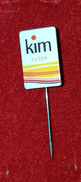 KIM, ORIGINAL VINTAGE CIGARETTE PIN BADGE - Around Cigarettes
