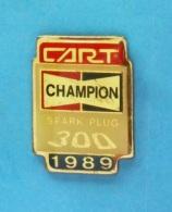 1 PIN'S //   ** CART ** BOUGIE CHAMPION ** SPARK PLUG 300 ** 1989 ** - Badges