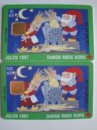 2 Chip Phonecards From Denmark - Sprites - Julen 1997 - Red Cross