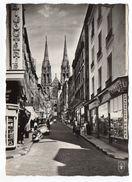 """CLERMONT-FERRAND-La Rue Des Gras Et La Cathédrale(animée,voitures,scooters,commerces) Griffe Linéaire""""CHARENTE MARITIME"""" - Clermont Ferrand"""