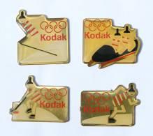 Lot De 4 Pin's  KODAK - Jeux Olympique D'hiver ALBERTVILLE 92 - Patinage - Saut à Ski - Hockey /glace - Bobsleigh - G401 - Photography