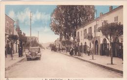 ALGERIE. EL ARROUCH. CPA . VOITURE ANNÉES TRENTE RUE PRINCIPALE - Andere Städte