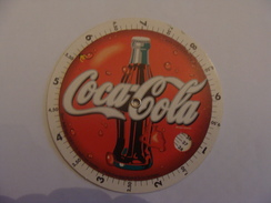PUBLICITE COCA COLA  DISQUE EN CARTON  POUR LES CALORIES NOMBRES DE LITRES BUS - Coca-Cola