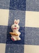 Feve  Dorée Lapin Avec Rouleau à Patisserie - Animaux