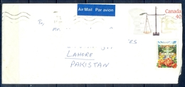 J450- Pre-Stamped Postal Used Cover. Posted From Canada To Pakistan. Flowers. Building. - Canada