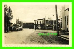 """TRACADIE, NEW BRUNSWICK - COUP D'OUIL DU SUD DE LA RUE PRINCIPALE - STATION SERVICE """"IRVING""""  GAS & OIL - TRAVEL  - - Nouveau-Brunswick"""