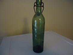 Bouteille De Bière Marquée En Relief  - De Fin Des Années 1920 - France - BOUDRET - CARMAUX -  0.49 L - Vide - Bouchon D - Beer